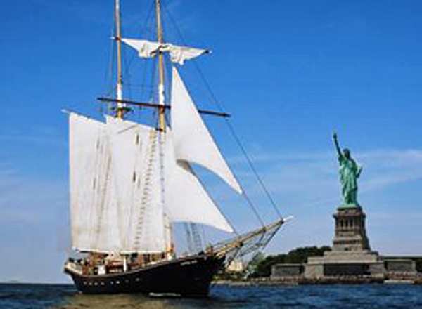 Clipper City Tall Ship sails around the Statue of Liberty and offers great views of the Manhattan skyline