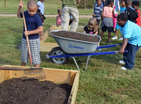 Halls Ferry Elementary School students assist in the preparation of eight new garden beds which were added to the school's Falcon Garden.