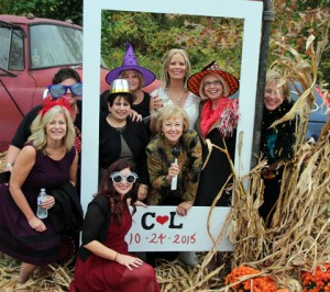 The Dining Divas posed for a group photo with leader and bride Lisa in a lifesize fall frame in her backyard. As they say: A good time was had by all.