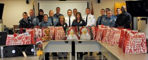 Florissant police officers with bags of toys for needy families