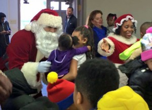 Santa and Mrs. Claus hand out presents at holiday party in Ferguson.