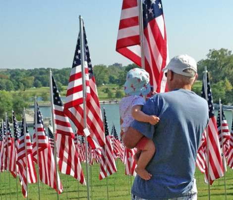 Tom Anselm with granddaugher overlooking  the thousands of American flags