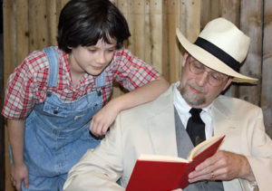 Scout and Atticus in the Alpha Players' adaptation of Harper Lee's To Kill a Mockingbird.