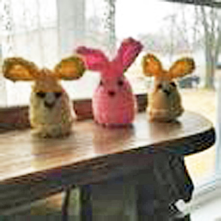 "Nextdoor user, Karen Sensabaugh, shows off the Easter Bunnies the ""Stitch and Chat"" group made."