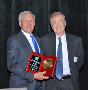 North County Inc. Board chairman Scott Negwer presents Independent News Editor and Publisher Bob Lindsey with the 2017 Elmer Belsha Leadership Award