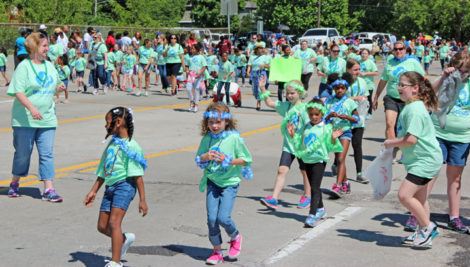Waves of Girl Scouts walked The Valley of Flowers Parade route on Sunday, May 7