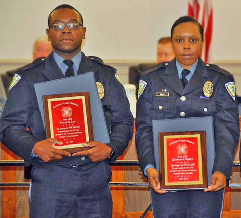 Officers Freddie Lee and Kimberly Berry holding their National Service Awards.