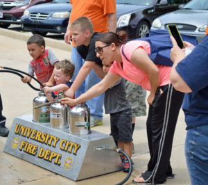 HFD's 'PUBLIC SAFETY DAY' OFFERS FUN ACITIVITES FOR KIDS: Children enjoyed playing the water extinguisher game and learning how to point water at an object using a small hose.