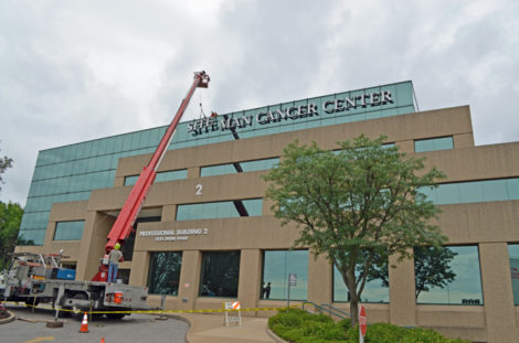 Putting up the sign June 30 for the new Siteman Cancer Center