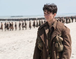 Fionn Whitehead as Tommy, a British private, awaits evacuation on the beach at Dunkirk.