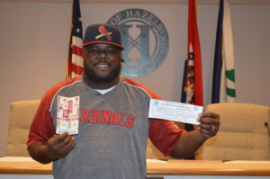Hazelwood resident Titus Reed was excited about winning his prize for turning in his recycling pledge card.  When he came to pick up his two Home Field Box Seat tickets to the St. Louis Cardinals' home game on August 24, he was dressed in Cardinals' gear and ready to go.