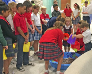 "Groups of students from each school North County Catholic school in the Federation of Catholic Schools added some loose change and bills to the ""pool"" of funds in support of hurricane relief efforts through Catholic Charities."