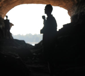 Silhouttte of tourist in Pirates Cave. -- Bob Lindsey photo