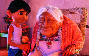 Miguel helps Mama Coco remember in 'Coco.'