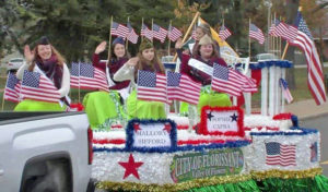 Valley of Flowers Queen and her Court rode in city's float in parade