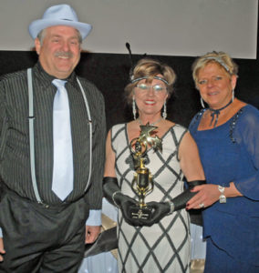 Chamber board chair Mike Moehlenkamp of Gary's Auto with board members Darla Tinker with US Bank and Kitty Harrison with Johnny Londoff Chevrolet wore attire fitting for the theme that night.