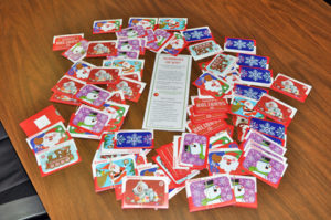The gigantic pile of 98, $100 Target gift cards that will be distributed throughout this year's Summons of Joy project.