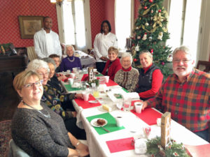 Pictured at the head of the table with friends is   Margaret Connors, former Florissant Councilwoman who represented ward 9 from 1984 to 1991. Standing next to Margaret Connors are two of the 10 McCluer High School students enrolled in the school's Culinary Arts Program who volunteered to help the Florissant Valley Historical Society host its Christmas luncheon.
