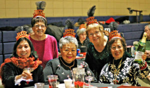 These ladies toasted the New Year as the clock struck 12 noon at the annual seniors party at the Florisssant Civic Center. Nichole Fetters Photo