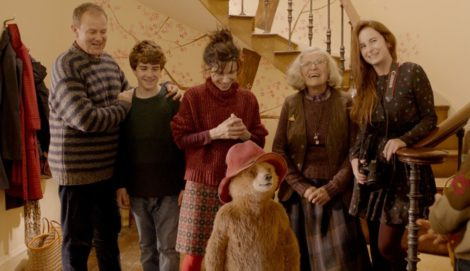 "Paddington (voice of Ben Whishaw) with his new family, the Browns (Hugh Bonneville, Samuel Joslin, Sally Hawkins, Julie Walters, Madeleine Harris), in ""Paddington 2."""